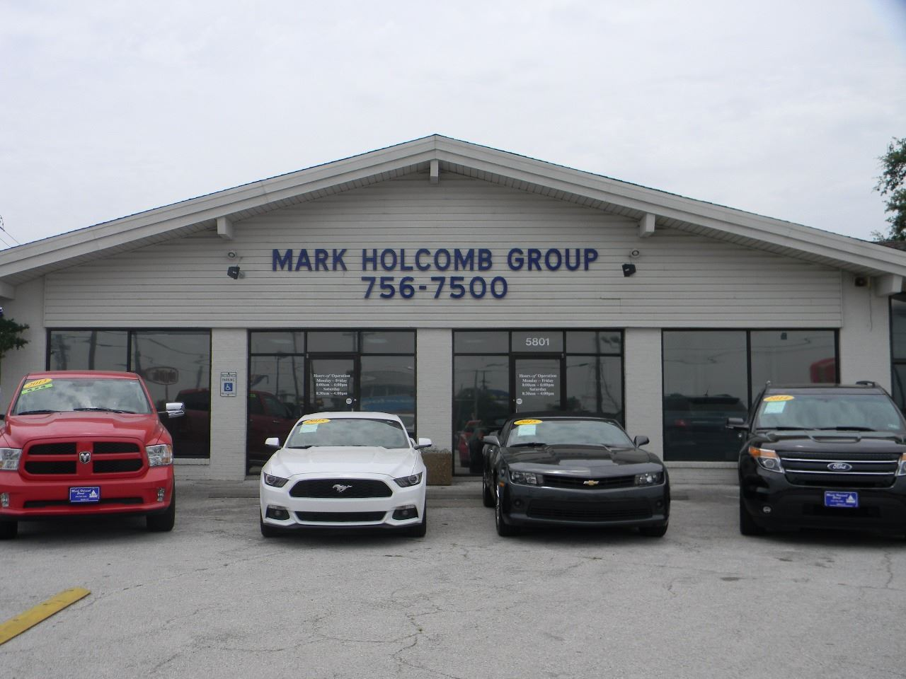 MARK HOLCOMB  GROUP PRE-OWNED